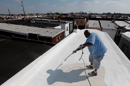 Painting a roof white in Philadelphia.