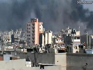 A screen grab of one angle taken in an hours-long live feed said to show shelling on Monday in the opposition stronghold of Homs, Syria.