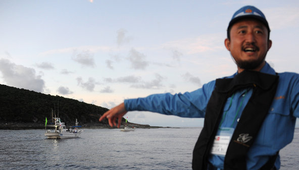 A Tokyo assemblyman, Eiji Kosaka, was part of a Japanese group that planted flags on a disputed East Asian island.