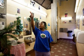 Hazel Chatman, a worker for the city's parks department, in the bathroom on the boardwalk in Brighton Beach where she is the caretaker, and decorator.