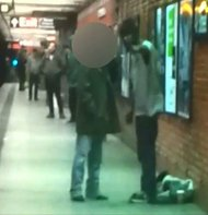 A still from a surveillance camera video in which the attacker is seen confronting the victim.