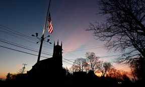 NYTimes: A flag at half-staff on Main Street in downtown Newtown on Saturday morning.