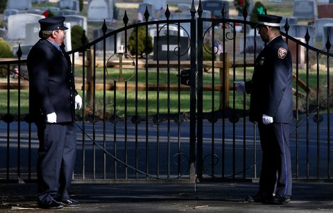 The gate of the St. Rose of Lima parish cemetery on Wednesday during the burial service of Daniel Barden, 7, one of the 26 victims of the shootings at Sandy Hook Elementary School, in Newtown, Conn.
