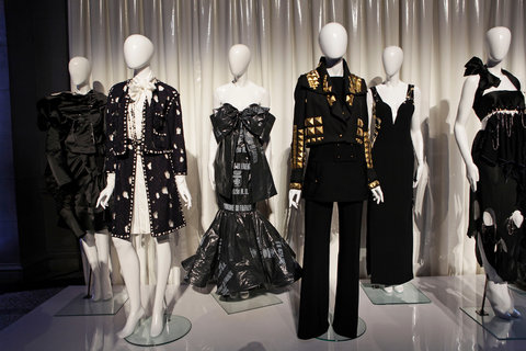 "Mannequins form the costume institute exhibition ""Punk: Chaos to Couture."" including the 1994 Moschino dress made of garbage bags (center)."