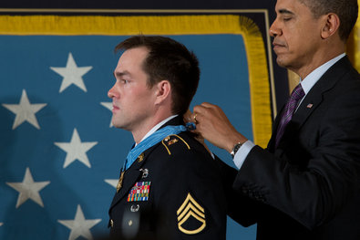 President Obama gave Clinton Romesha, a retired Army staff sergeant, the Medal of Honor in the East Room of the White House on Monday.