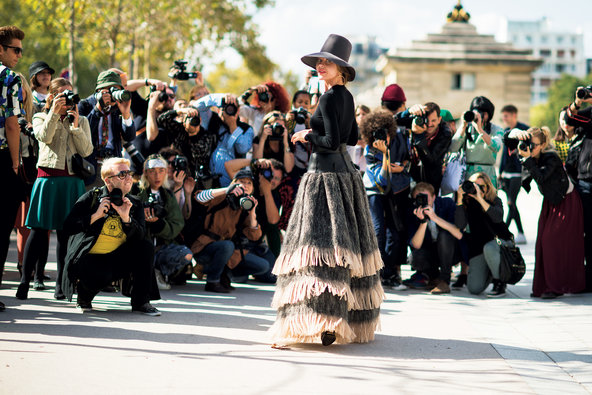 The street-style magnet Ulyana Sergeenko, who often changes outfits multiple times a day, twirls for the cameras during Paris's fashion week last September.