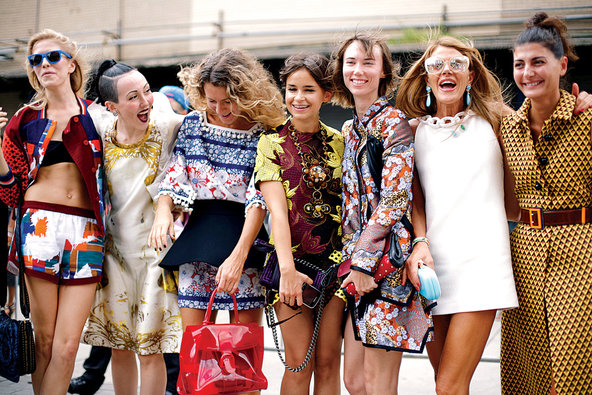 The streetstyle gaggle, from left: Elena Perminova, Michelle Harper, Natalie Joos, Miroslava Duma, Anya Ziourova, Anna Dello Russo, Giovanna Battaglia.