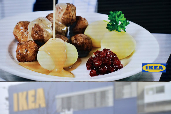 A billboard advertising meatballs is displayed in front of an IKEA store in Brno, Czech Republic.
