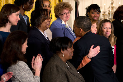 President Obama hugged a group of mothers who were victims of gun violence as he urged Congress to pass measures aimed at preventing it during an event in the East Room of the White House.