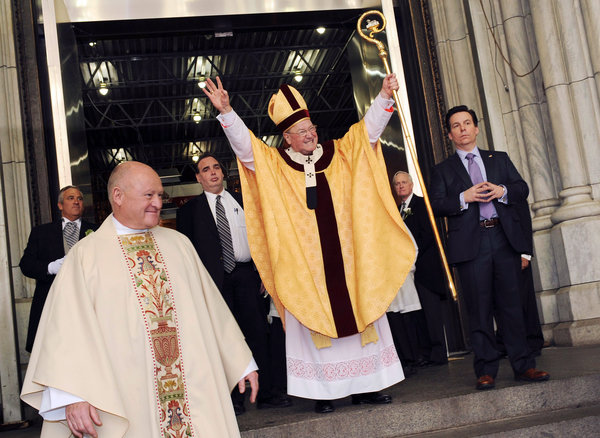 Cardinal Timothy M. Dolan greeted a crowd outside St. Patrick's Cathedral on Easter Sunday in New York.