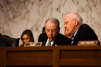 Senator Charles E. Grassley, left, conferred with Senator Patrick J. Leahy during a Judiciary Committee hearing on the immigration bill Monday.