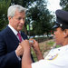 Jamie Dimon, chief of JPMorgan, showing ID to security at the Justice Department.