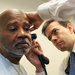 Dr. Michael Holliday examining Andre Jones at the University of Cincinnati Health Primary Care in Sharonville, Ohio.