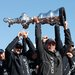 The skipper of Oracle Team USA, Jimmy Spithill, left, and its owner, Larry Ellison, holding the America's Cup on Wednesday.