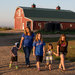 Mike and Kim Sorenson with their children on their farm in Ross, N.D. The Sorensons are fighting a relative's offer to lease his land to a company that wants to build an oil drilling waste dump.