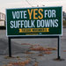 Signs encouraging residents to vote for a casino at Suffolk Downs trade on a nostalgic connection.