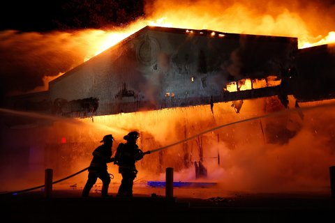 Fire roared through a Little Caesar's restaurant on Monday night in Ferguson, Mo.