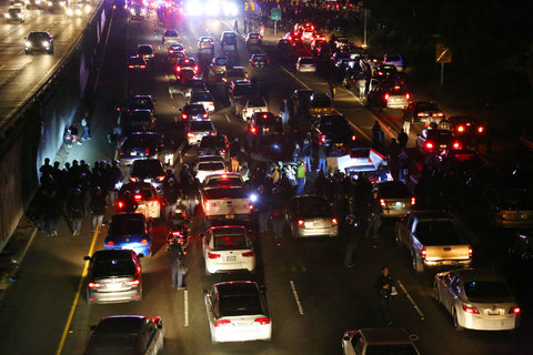 Protesters in Oakland blocked a highway on Monday night in response to the grand jury's decision in Ferguson, Mo.