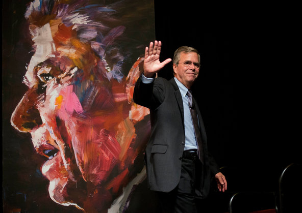Jeb Bush walked past a portrait of former President Ronald Reagan after speaking at the RedState Gathering in Atlanta on Saturday.