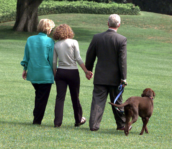 The Clintons and their dog Buddy leaving the White House for Martha's Vineyard in August 1998.
