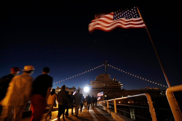 Supporters walk to a Donald J. Trump rally aboard the aircraft carrier USS Yorktown in Mt. Pleasant, S.C., on Monday.