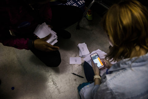 Counting votes during a Democratic caucus in Iowa City on Monday night. Senator Bernie Sanders's campaign said not all precincts had been properly staffed.