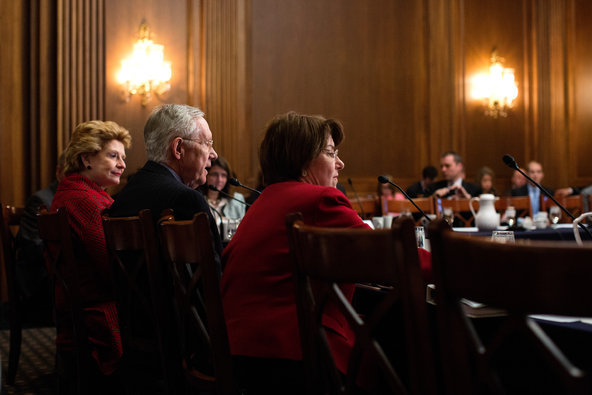 """Senator Harry Reid of Nevada, center, at the Capitol last month. """"It is a sad day for Republicans when they decide to bow to Trump,"""" he said."""