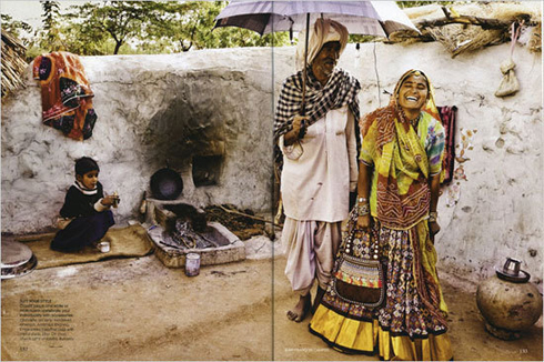 A Jean-François Campos photograph from the August 2008 edition of Vogue India features a poor Indian family -- and a $200 Burberry parasol.