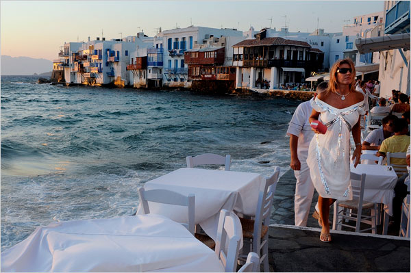 Waterfront restaurants and cafes in Mykonos Town. The Little Venice area is shown in the background.