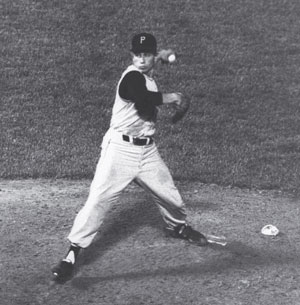 Harvey Haddix pitching during his twelve perfect innings before losing to the Milwaukee Braves on May 26, 1959.