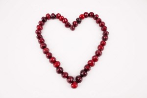 Heart shape with cherries stock photo