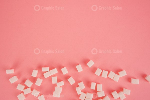 Cube sugar on bright pink stock image