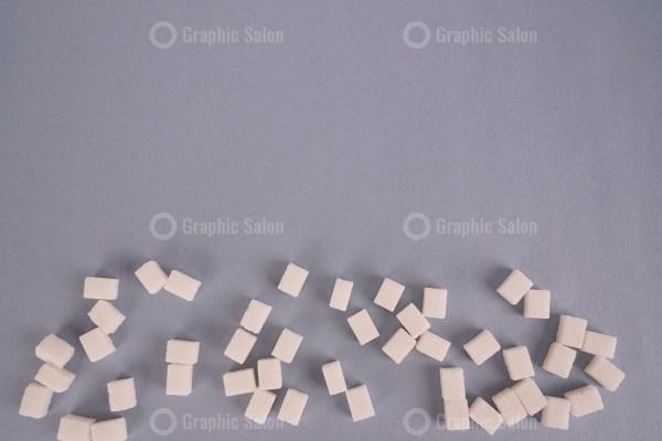 Lump sugar on grey stock photo
