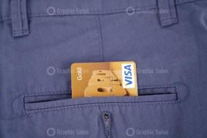 Visa credit card in pocket
