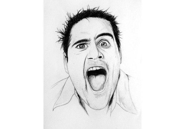 portrait expressif homme de face grimacant