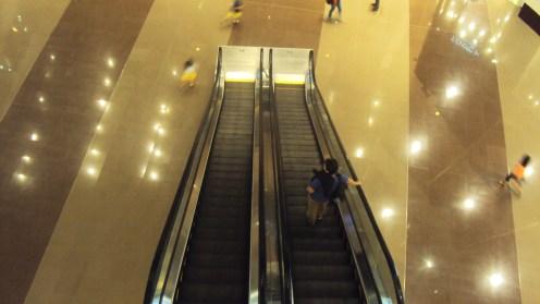 Alone in an escalator.