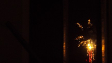 Capturing fireworks from a window's reflection