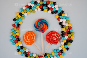 Colored round lollipops and candies on blue background