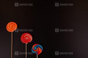 Colorful lollipops on black background