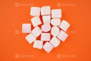 Marshmallows isolated on orange background stock image