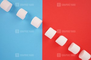 Pattern with marshmallow candies on colored background