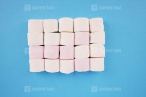 Pile of marshmallow on blue background stock image