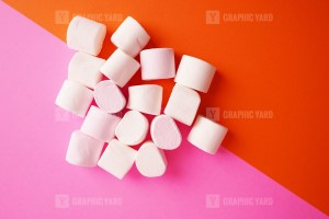 Pile of marshmallow on colorful background stock image