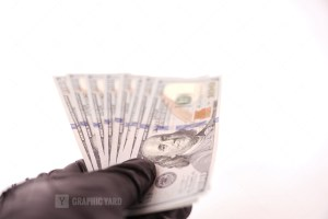 Black Leather Gloves Holding Money