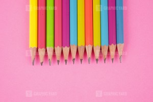Colored Pencils on Pink background