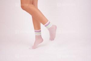 Female stand in white trendy socks