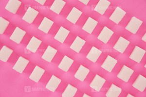 Refined sugar on pink background