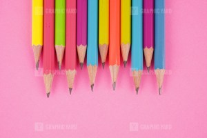 Top View Colored Pencils on Pink background