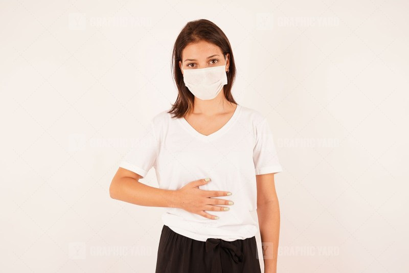 Woman in medical mask having stomach ache