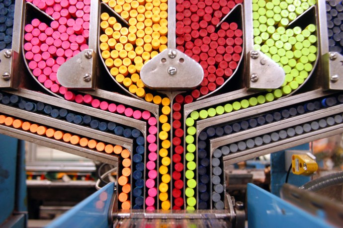 EASTON, PA - JUNE 18: A packaging machine sorts crayons while moving them towards individual boxes at Binney and Smith, Inc., the manufacturer of Crayola crayons June 18, 2003 in Easton, Pennsylvania. Binney and Smith, Inc. are celebrating the 100th anniversary of the first box of Crayola crayons. Introduced in 1903, a box of Crayola crayons sold for a nickel and included the same eight colors available today: red, blue, yellow, violet, orange, black, and brown. (Photo by William Thomas Cain/Getty Images)